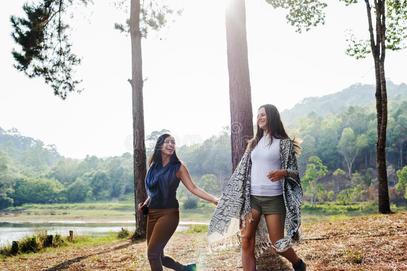 Girls Friends Exploring Outdoors Nature Concept royalty free stock image