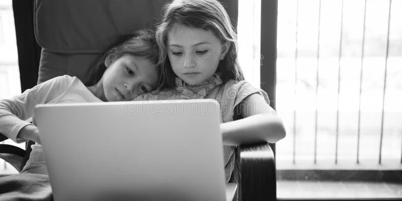 Girls Friends Laptop Using Concept stock photo