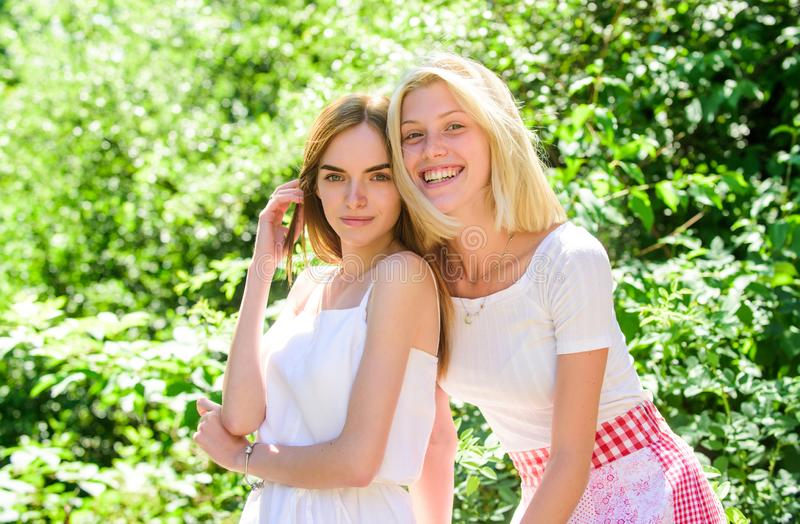 Girls friends nature background. Friendly close relations. Revelation and sincerity. Trustful friends communication. Carefree youth friends hang out outdoors stock image