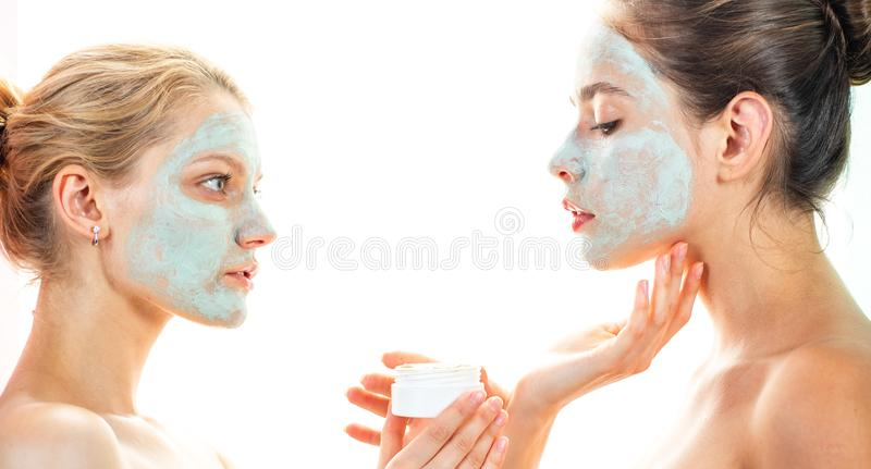 Girls friends sisters making clay facial mask. Anti age care. Stay beautiful. Skin care for all ages. Women having fun stock photography