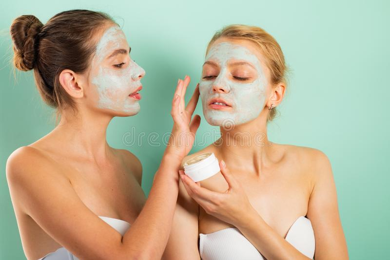 Girls friends sisters making clay facial mask. Anti age mask. Stay beautiful. Skin care for all ages. Women having fun stock images