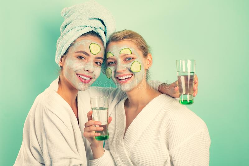Girls friends sisters making clay facial mask. Anti age mask. Stay beautiful. Skin care for all ages. Women having fun royalty free stock photography