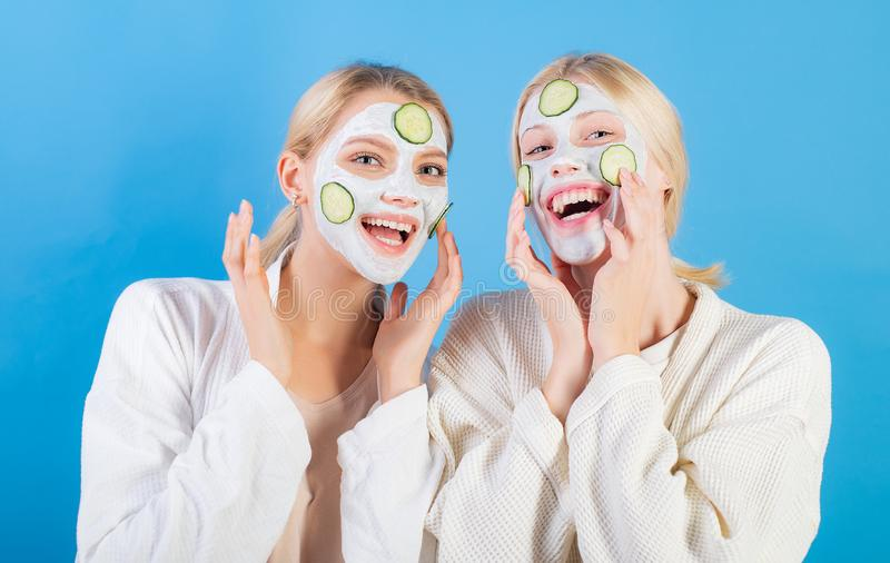 Girls friends, sisters or mom and daughter chilling making clay facial mask. Anti age mask. Stay beautiful. Skin care royalty free stock images