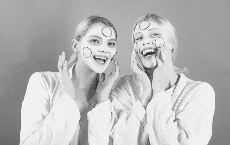 Girls friends, sisters or mom and daughter chilling making clay facial mask. Anti age mask. Stay beautiful. Skin care stock photos