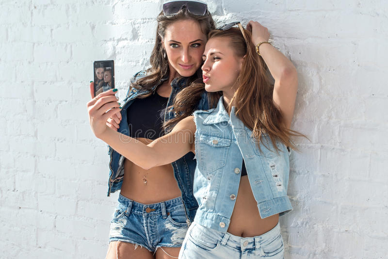 Girls friends taking selfie picture. Two beautiful stock images