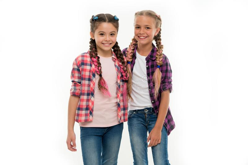 Girls friends wear similar outfits have same hairstyle kanekalon braids white background. Sisters family look outfit. Dress similar with best friend. Dress to stock photography