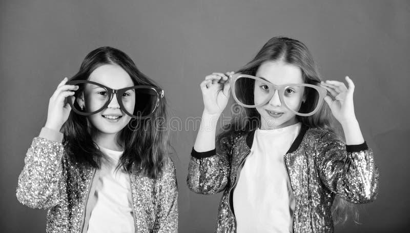 Girls funny big eyeglasses cheerful smile. Birthday party. Happy childhood. Sincere cheerful kids share happiness and. Love. Joyful and cheerful. Sisterhood stock image