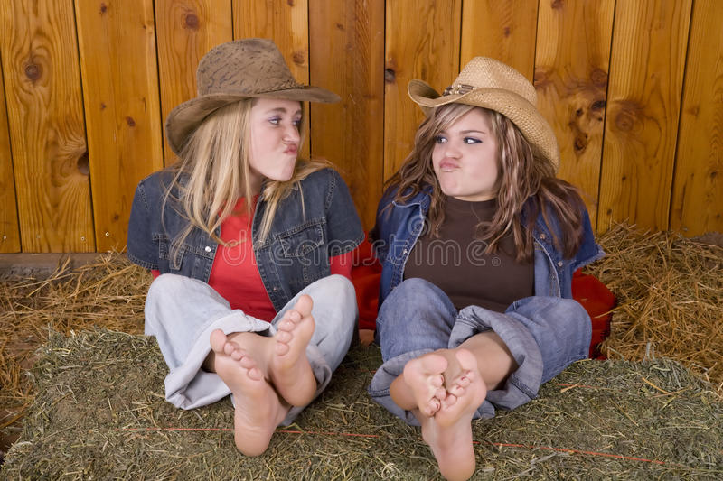 Download Girls Funny Face Feet On Hay Stock Image - Image: 12018951