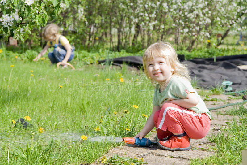 Girls in the garden stock photography