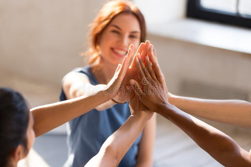 Girls giving high five, close up focus on hands stock photo