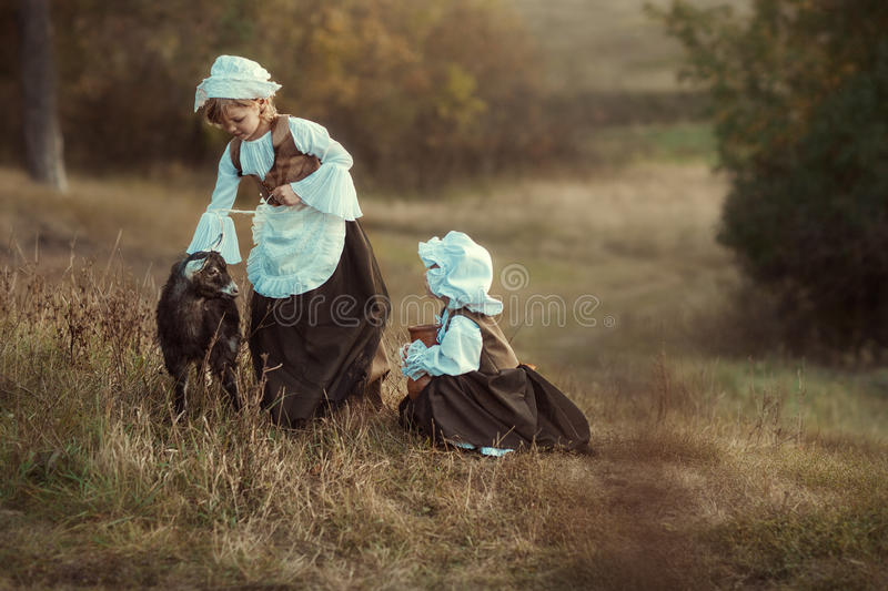girls and goats royalty free stock images