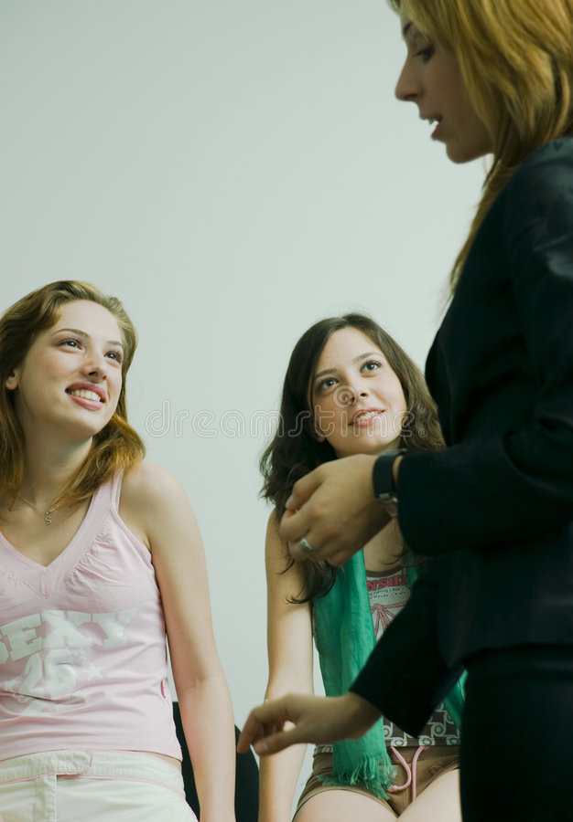 Girls gossiping royalty free stock image