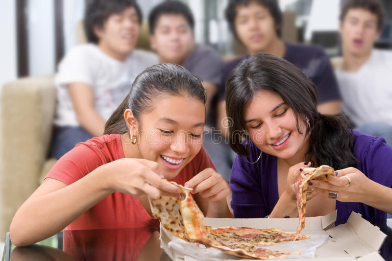 Download Girls Got The First Chance To Eat Pizza Stock Photo - Image: 9460960