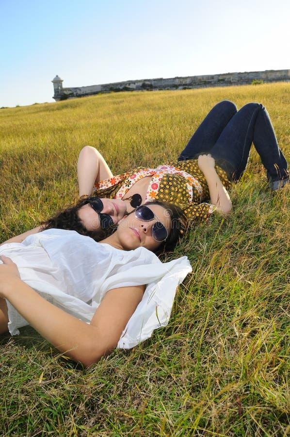 Girls on green field stock photos