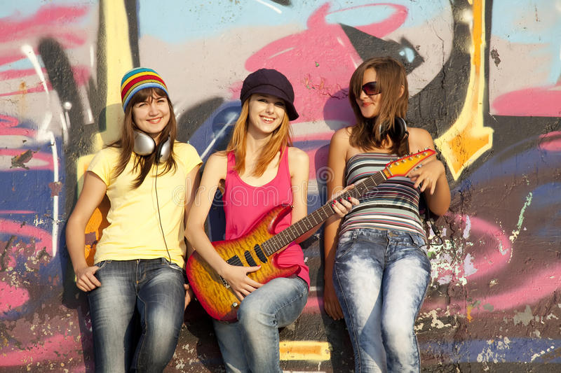 Download Girls With Guitar And Graffiti Wall Stock Image - Image: 20394697
