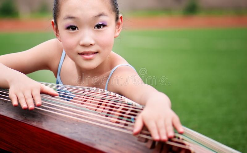 Girls and Guqin royalty free stock photos