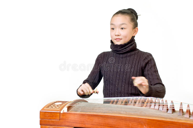 Girls(Guzheng performance) stock images