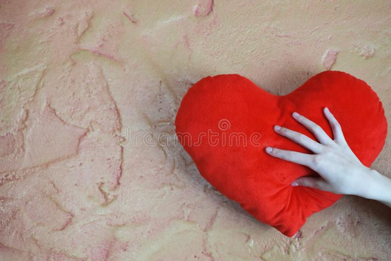Girls hand hold toy heart royalty free stock photo