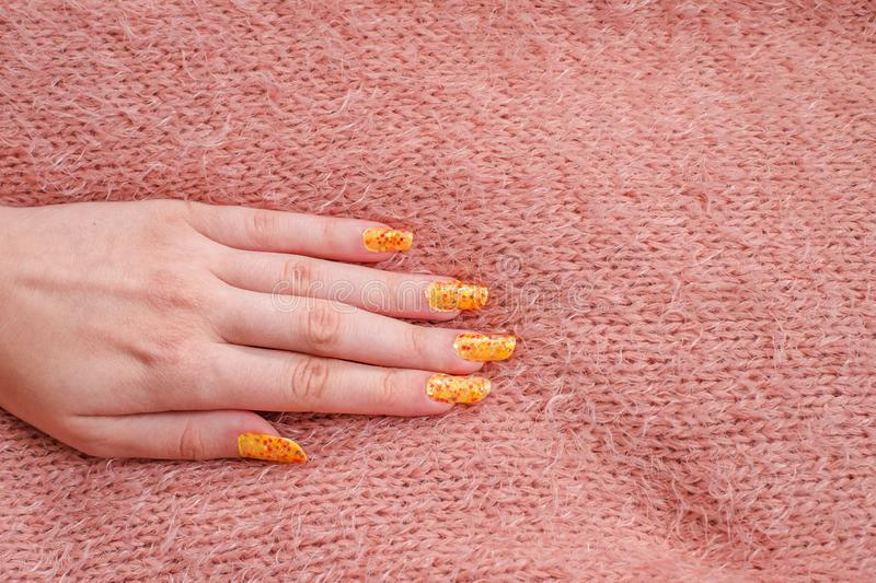 Girls hand with nailart on sweater. Close view stock photo