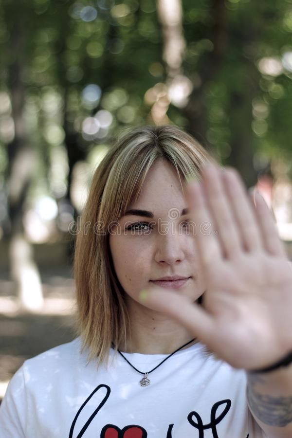 Girls hand stop signal. A girl showing left hand in front of the camera. stop signal stock image