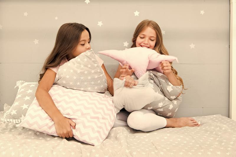 Girls happy friends with cute pillows. Pillow fight pajama party. Sleepover time for pillow fight. Doing whatever they. Want. Girls sleepover party ideas stock images