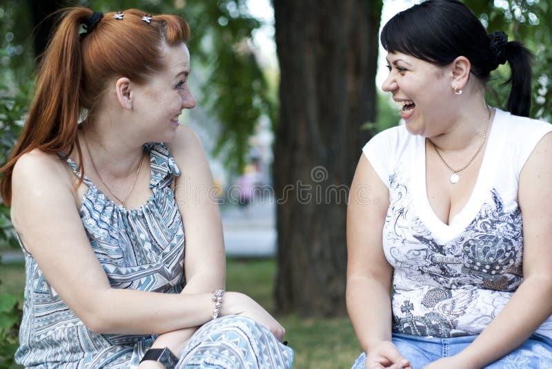 Girls having a conversation royalty free stock photos