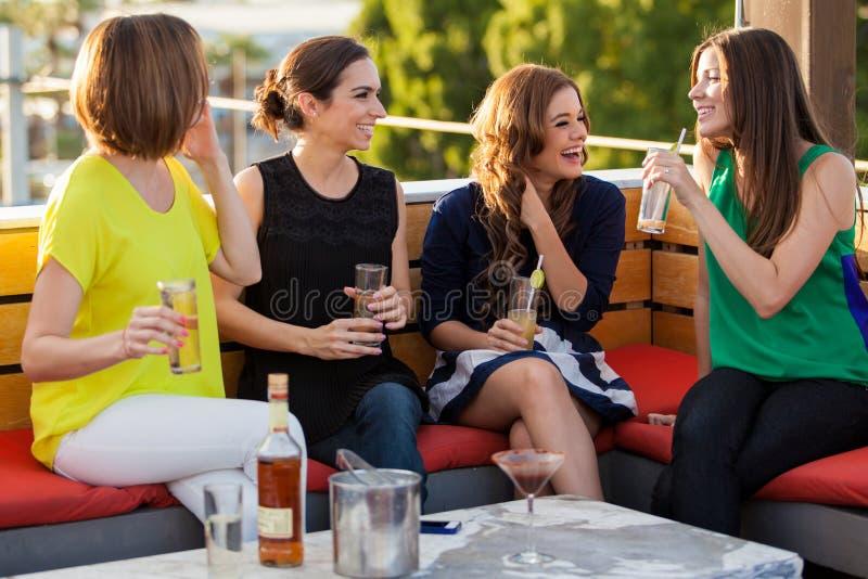 Girls having fun at a bar royalty free stock images