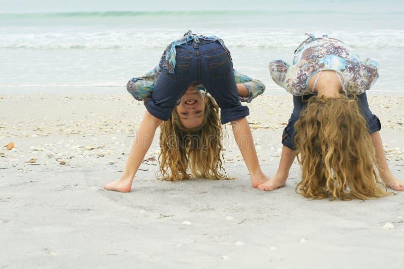Girls having fun on the beach royalty free stock photos