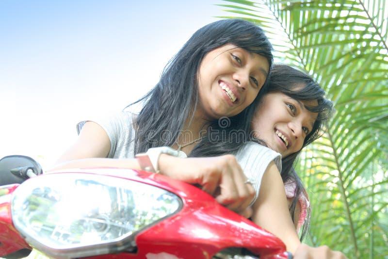 Girls having fun on bike