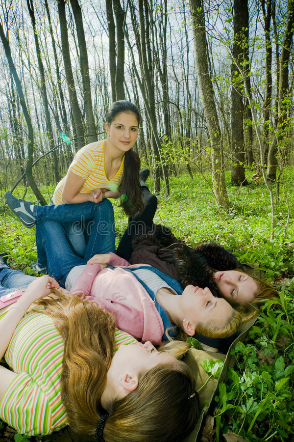 girls having fun in the forest royalty free stock photography