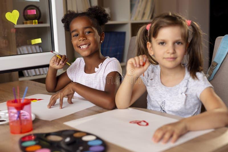 Girls having fun painting royalty free stock image