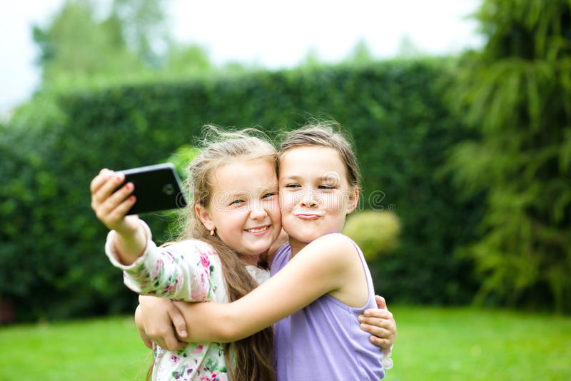 Girls having fun taking selfie royalty free stock photos