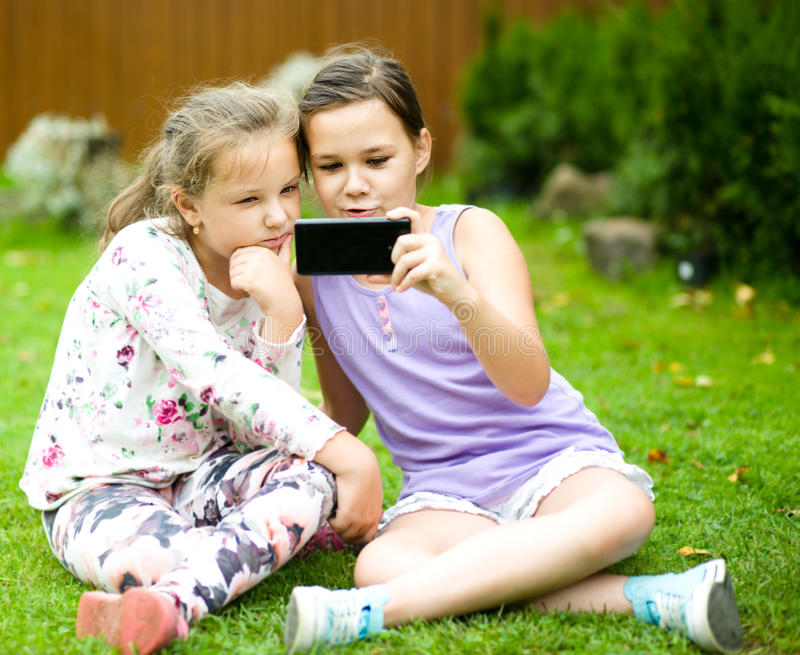 Girls having fun taking selfie stock images