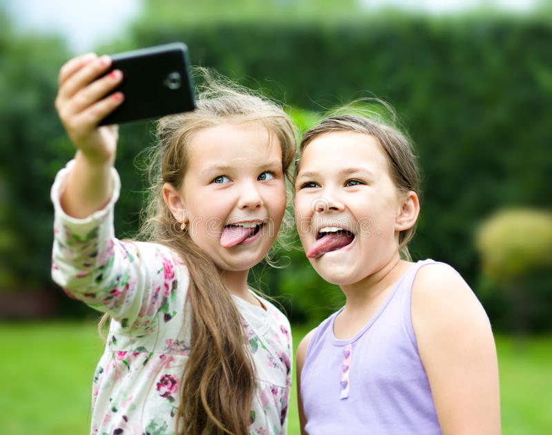 Girls having fun taking selfie stock photography