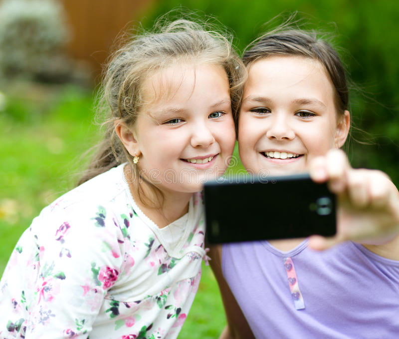 Girls having fun taking selfie royalty free stock photography