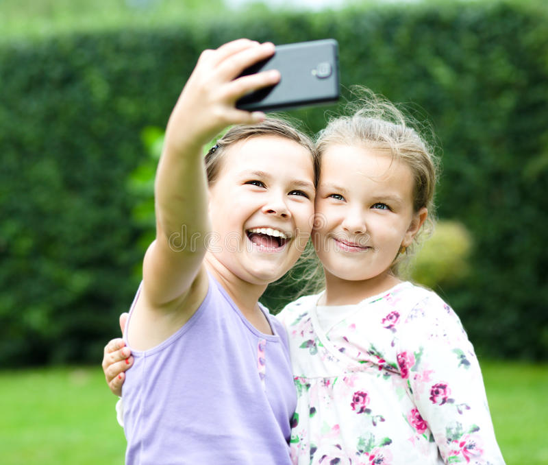 Girls having fun taking selfie royalty free stock image