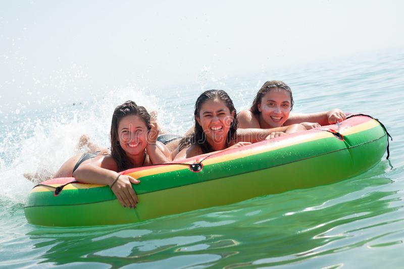 Girls having fun in the water stock photo