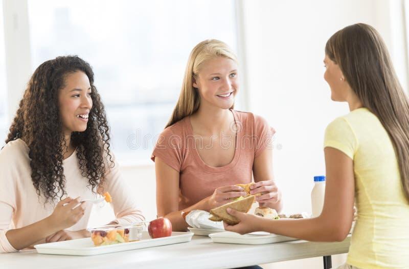 Download Girls Having Snacks In University Canteen Stock Image - Image: 33616127