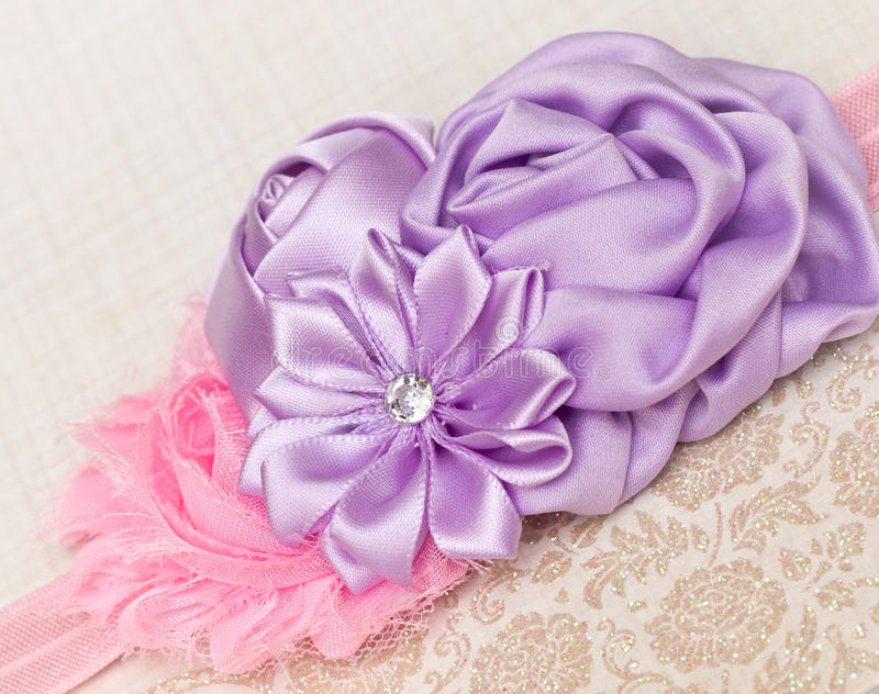 Girls Headband. Pink shabby flower with rosettes and a diamonte. royalty free stock image