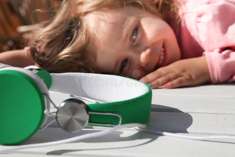 Download Girls&Headphones stock image. Image of green, young, summer - 32142857