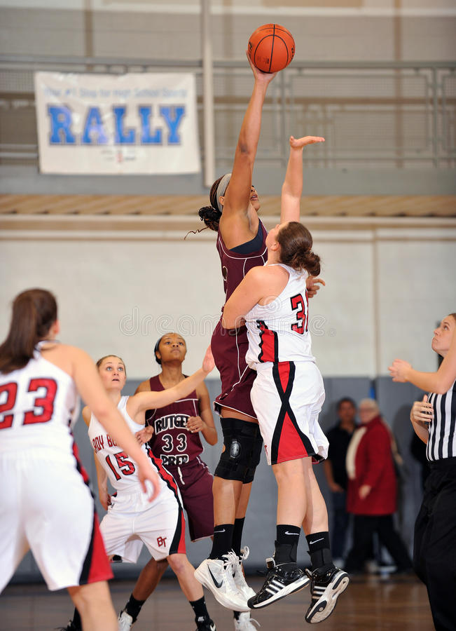 Girls High School Basketball. PHILADELPHIA - JANUARY 14: Marvadene Anderson (#23), at 6'11, dominates the opening tip for Rutgers Prep in a game against royalty free stock photos