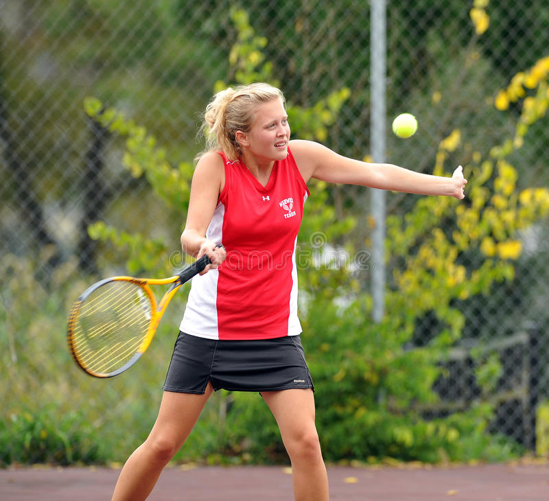 Girls High School Tennis. LITITZ, PA - SEPTEMBER 27: Unnamed girl's tennis player from Warwick High School hits a backhand during a match against Solanco High royalty free stock photography