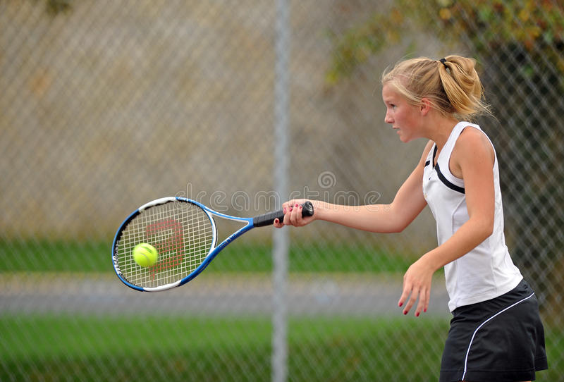 Girls High School Tennis. LITITZ, PA - SEPTEMBER 27: Unnamed girl's tennis player from Solanco High School hits a forehand during a match against Warwick High stock photography