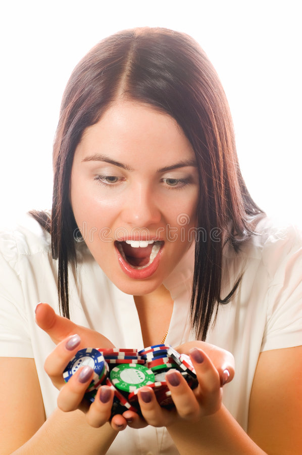Girls holding a bunch of poker chips royalty free stock images