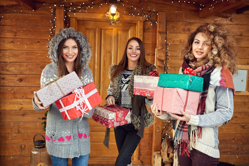 Girls holding Christmas gifts royalty free stock photography