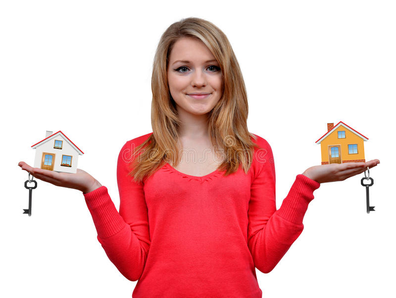 Girls holding in hands house and key stock photo