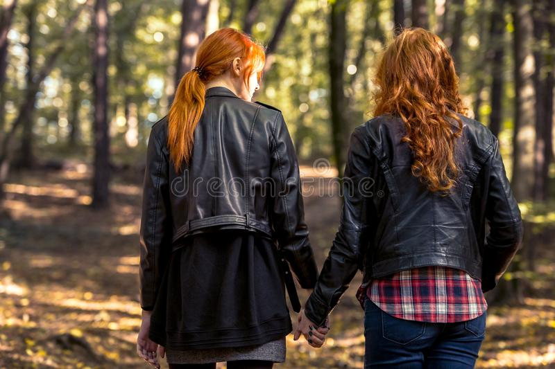 Girls holding hands royalty free stock photography
