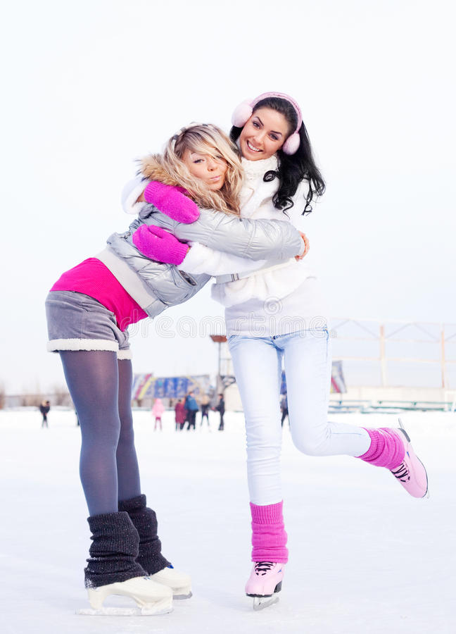 Girls ice skating stock photography
