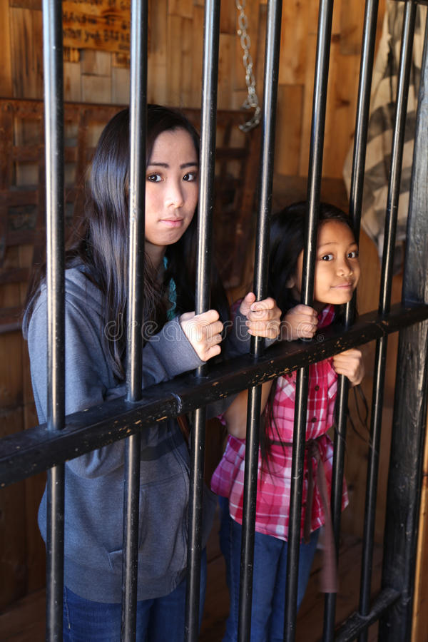 Girls in jail stock images