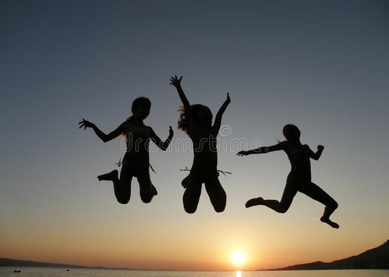 Download Girls jumping in sunset stock image. Image of concept - 11178663